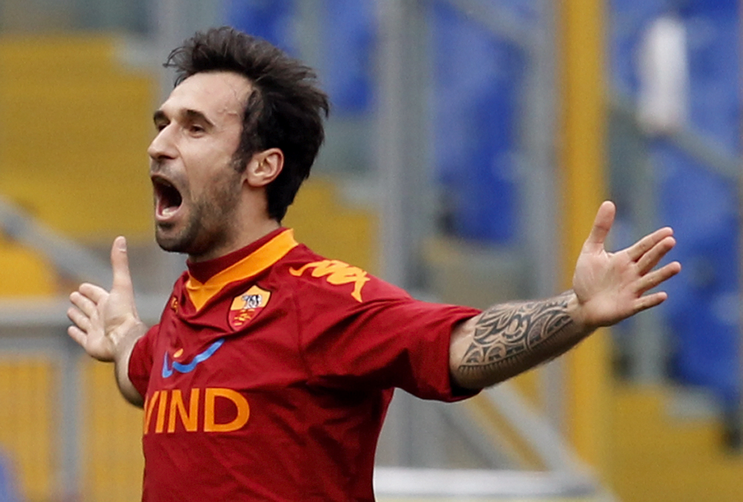 AS Roma's Vucinic celebrates after scoring against Catania during their Italian Serie A soccer match in Rome